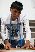 A textile workshop which is supported and funded by CAMI, an organistation that supports migrants in  São Paulo, Brazil.<br /> <br /> Each year, CAMI helps over 5,700 people to be legalised in the country. Their courses are attended by 500-700 people annually, while 12,000-14,000 immigrants take part in their events. They also distribute over 60,000 newspapers in the city.