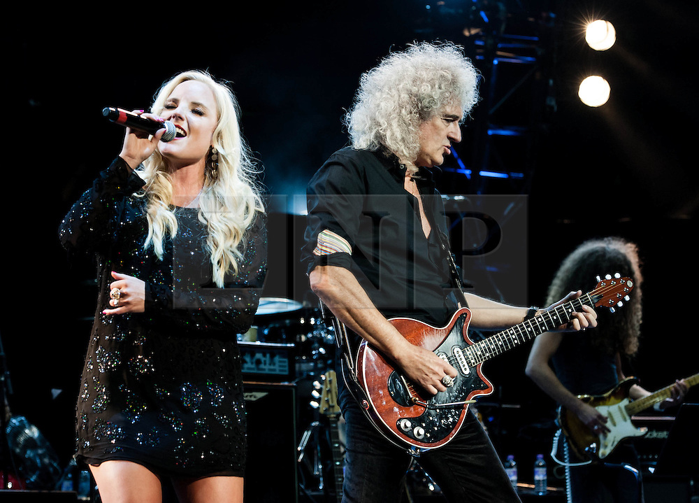 """© Licensed to London News Pictures. 16/09/2012. London, UK.  Kery Ellis (L) Brian May (Right) perform at The Sunflower Jam at the Royal Albert Hall.  The Sunflower Jam is a British charity, founded by Jacky Paice, wife of Deep Purple drummer, Ian Paice. Other high-profile supporters are the actor Jeremy Irons, ex-Jamiroquai bassist Nick Fyffe and Charles, Prince of Wales. The aims of the charity are to fund complementary therapists and spiritual healers to work on cancer wards in the British National Health Service. After setting up a meeting between members of Deep Purple and a young boy dying of leukemia, Paice saw """"all the good work the healers were doing"""" and decided """"lets find a way to raise money to get more healers in there. Brian May is a founding member and guitarist of Queen, Kerry Ellis is a lead singer in West End Musicals and played the role of 'Meat' in Queen's We Will Rock You  Photo credit : Richard Isaac/LNP"""