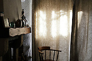 closed curtains with chair by fireplace