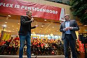 Voorzitter Han Busker (rechts) en vice-voorzitter Tuur Elzinga spreken de menigte toe. In Utrecht zijn zo'n duizend FNV-leden bij het vakbondshuis gekomen om als actieberaad te praten over de eerder besproken hoofdlijnen van het actieplan vast te stellen. De vakbond komt in actie na het mislukken van het pensioenakkoord waarvoor de vakbond de schuld heeft gekregen.<br /> <br /> Chairman Han Busker and vice- chairman Tuur Elzinga talk to the audience. In Utrecht around thousand members of the trade union FNV gather to discuss the actions the trade union has to take after the collapse of an agreement on the pensions with the government.