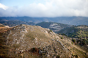 Mountains in the Chania region at the island of Crete in Greece. Chania is one of the four regional units of Crete; it covers the westernmost quarter of the island. The western part of Crete is bounded to the north by the Cretan Sea, and to the west and south by the Mediterranean Sea.