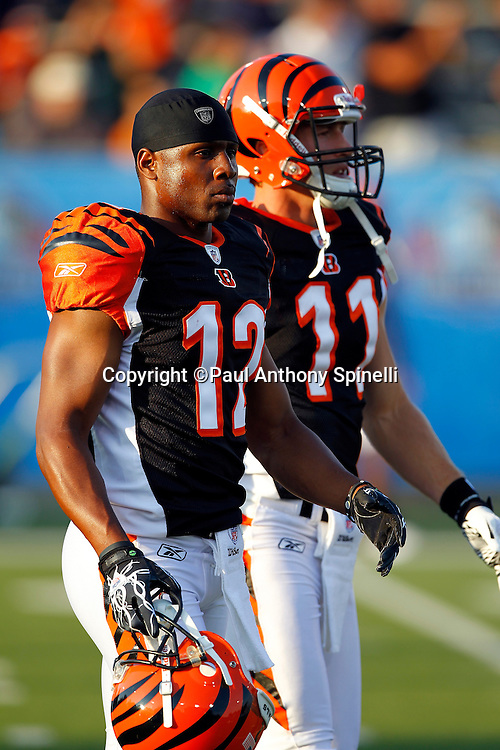 Cincinnati Bengals wide receivers Quan Cosby (12) and rookie Jordan Shipley (11) walk off the field after pregame warmups during the NFL Pro Football Hall of Fame preseason football game between the Dallas Cowboys and the Cincinnati Bengals on Sunday, August 8, 2010 in Canton, Ohio. The Cowboys won the game 16-7. (©Paul Anthony Spinelli)