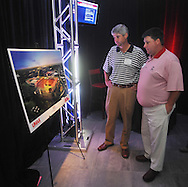 Chris Hill, left, and Mac Samples look over drawings of the proposed expansion of the University of Mississippi's Vaught-Hemingway Stadium during a presentation in Oxford, Miss. on Tuesday, AUgust 9, 2011. The university announced a $150 million capital improvement campaign to build a new basketball arena and expand Vaught-Hemingway Stadium. (AP Photo/Oxford Eagle, Bruce Newman)