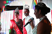 Kimberly Carter, from left, and Dwight Cox smile Saturday at the Circus Masquerade as Selena Leon talks about what their titles of Queen and King of Shoals Pridefest entail. Carter and Cox are the first Queen and King of Shoals Pridefest.