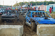 Competitiors kick up copious amounts of mud during demolition derby at the Summitt County Fairgrounds, Thursday, July 26, 2016 in Tallmadge, Ohio. All cars participating had previously been used in at least one demoltion derby.