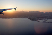FlyNiki Airbus 321 shortly after take-off from Palma de Mallorca Airport at sunset, flying over Palma and Porto Pi.
