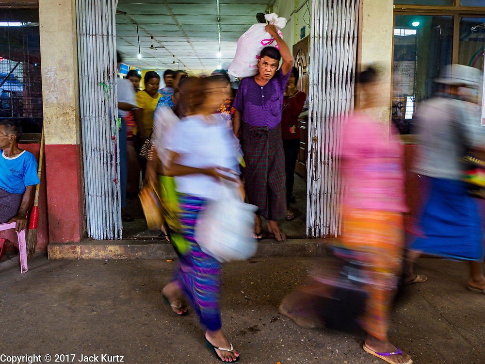 20 NOVEMBER 2017 - YANGON, MYANMAR: Passengers leave the Yangon ferry terminal and walk down to the pier to board the ferry for Dala. Tens of thousands of commuters ride the ferry every day. It brings workers into Yangon from Dala, a working class community across the river from Yangon. A bridge is being built across the river, downstream from the ferry to make it easier for commuters to get into the city.     PHOTO BY JACK KURTZ