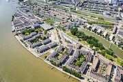 Nederland, Zuid-Holland, Rotterdam, 10-06-2015; Feijenoord. Simonsterrein aan weerszijden van de Feijenoordhaven, met bouwblokken van de sociale woningbouw op terrein van voormalig scheepssloopbedrijf Simons. Nassauhaven en Persoonshaven (links).<br /> Social housing in Rotterdam-South, build on the site of a former ship demolition yard. <br /> luchtfoto (toeslag op standard tarieven);<br /> aerial photo (additional fee required);<br /> copyright foto/photo Siebe Swart