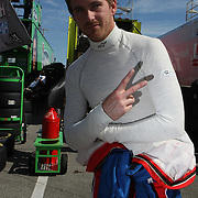 NASCAR driver Scott Speed flashes a peace sign in the garage area, during a NASCAR Daytona 500 practice session at Daytona International Speedway on Wednesday, February 20, 2013 in Daytona Beach, Florida.  (AP Photo/Alex Menendez)