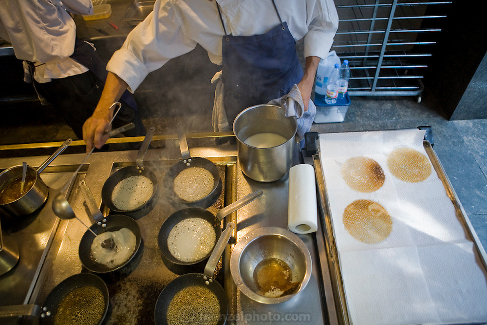 A chef prepares food (small crepes) at El Bulli restaurant near Rosas on the Costa Brava in Northern Spain.