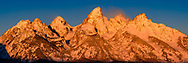 The last sunrise of 2016 covers the Teton Mountains in a golden glow while strong winds gust around the peaks. This is a 100 megapixel panorama and is suitable for large prints.