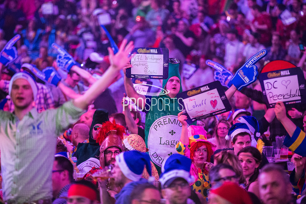 Dart fans at the Alexandra Palace watching the darts during the World Darts Championship at Alexandra Palace, London, United Kingdom on 1st January 2016. Photo by Shane Healey.