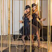 NLD/Amsterdam/20161208 - Vipnight 10de Masters of LXRY, Danseressen in een kooi