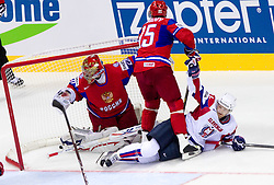 Andrej Hebar of Slovenia (R) scores vs Yevgeni Nabokov of Russia and  Alexei Morozov of Russia during ice-hockey match between Russia and Slovenia of Group A of IIHF 2011 World Championship Slovakia, on May 1, 2011 in Orange Arena, Bratislava, Slovakia. (Photo By Vid Ponikvar / Sportida.com)