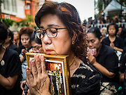 26 NOVEMBER 2016 - BANGKOK, THAILAND: People pray for the late king of Thailand in Bangkok's Chinatown. Thousands of people gathered on Yaowarat Road in the heart of Bangkok's Chinatown to honor Bhumibol Adulyadej, the Late King of Thailand. The event was organized by the Thai-Chinese community and included a performance by the Royal Thai Navy orchestra of music composed by the Late King, a prayer by hundreds of Buddhist monks. It concluded with a candlelight vigil. The King died after a long hospitalization on October 13. The government has declared a one year mourning period. HRH Crown Prince Maha Vajiralongkorn, the Heir Apparent and Late King's son, is expected to be name the King next week. He will be known as Rama X.       PHOTO BY JACK KURTZ