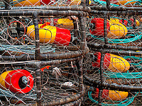 Bright colored Dungeness Crab pots and floats, stacked and ready for opening of commercial crab fishing season, Kodiak, Alaska, Summer.