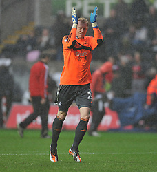 Swansea City's Gerhard Tremmel claps the swansea fans after there performance.  - Photo mandatory by-line: Alex James/JMP - Tel: Mobile: 07966 386802 01/01/2014 - SPORT - FOOTBALL - Liberty Stadium - Swansea - Swansea City v Manchester City - Barclays Premier League