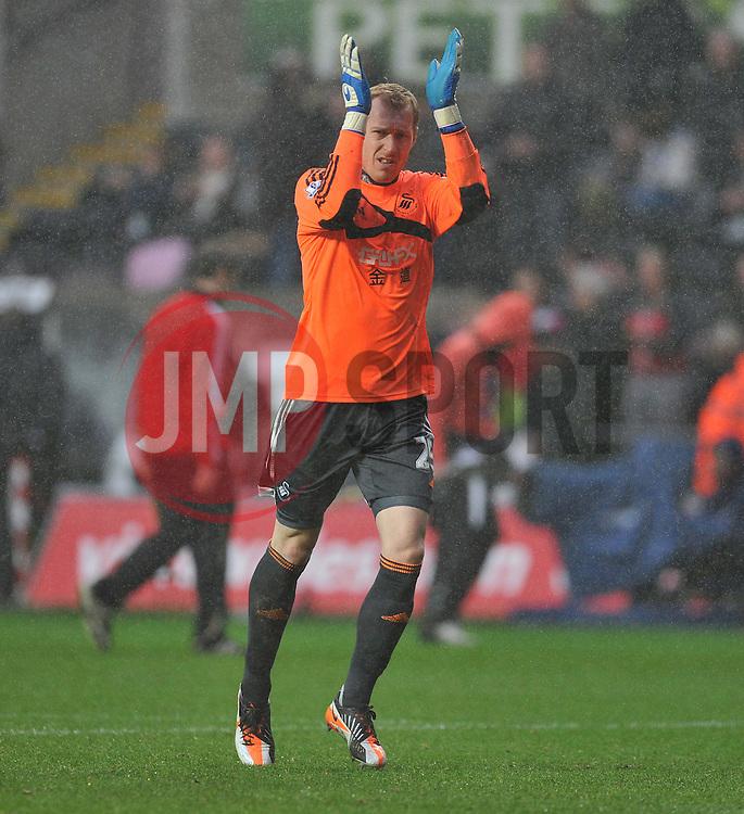 Swansea City's Gerhard Tremmel claps the swansea fans after there performance.  - Photo mandatory by-line: Alex James/JMP - Tel: Mobile: 07966 386802 01/01/2014 - SPORT - FOOTBALL - Liberty Stadium - Swansea - Swansea City v Manchester City - Barclays Premier League