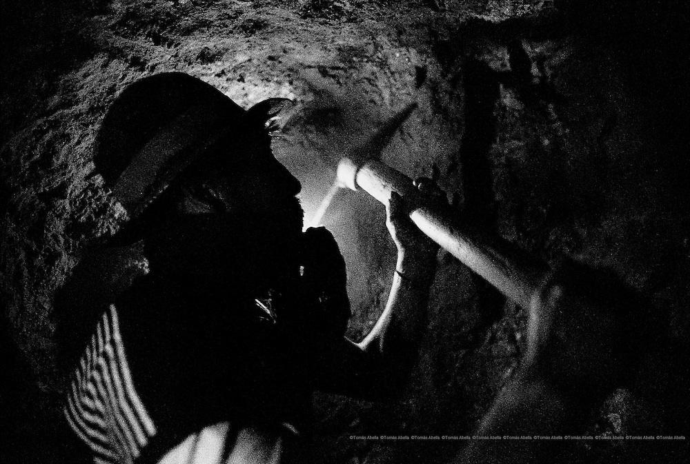 Extracting silver in Cerro Rico of Potosí. Bolivia.