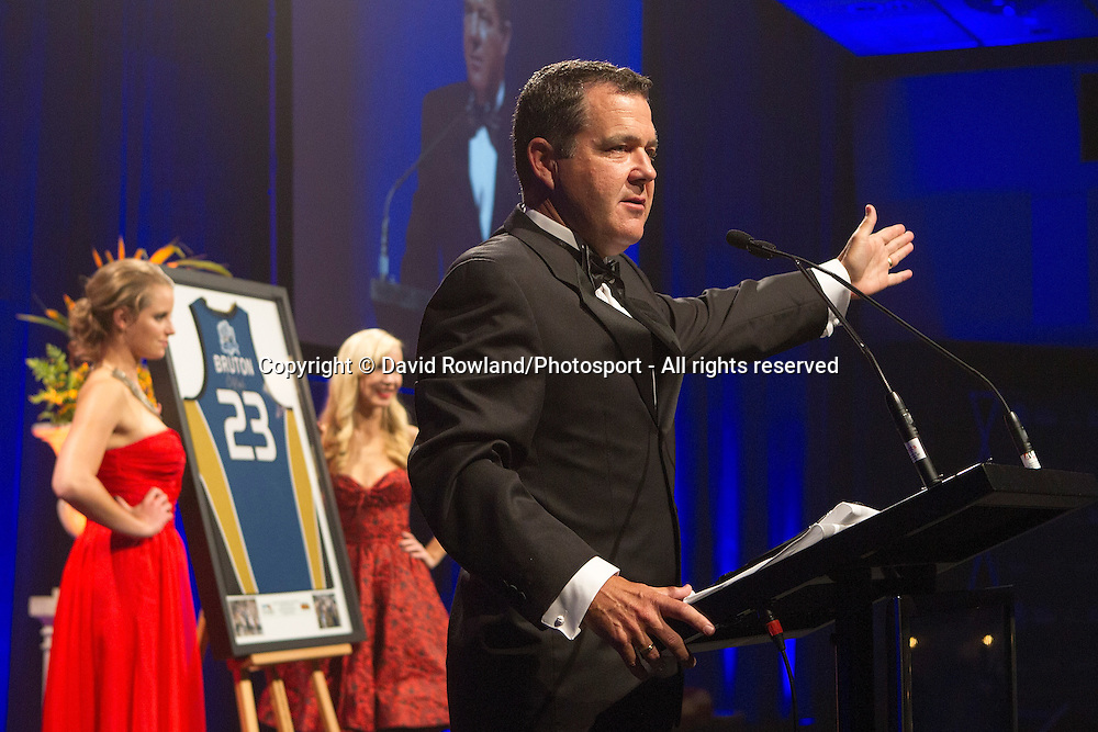 Master of Ceremonies Andrew Dewhurst auctions Breakers' CJ Bruton shirt at the Skycity Breakers Awards, 2013-14, Skycity Convention Centre, Auckland, New Zealand, Friday, March 28, 2014. Photo: David Rowland/Photosport