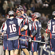 Members of the Boston Cannons celebrate a goal during the game at Harvard Stadium on May 10, 2014 in Boston, Massachusetts. (Photo by Elan Kawesch)