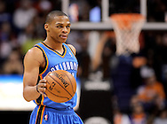 Jan. 14, 2013; Phoenix, AZ, USA; Oklahoma City Thunder guard Russell Westbrook (0) handles the ball during the game against the Phoenix Suns in the first half at US Airways Center. Mandatory Credit: Jennifer Stewart-USA TODAY Sports..