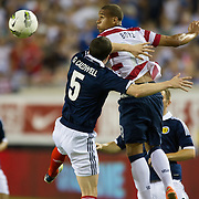 May 26 2012: USA's Terrence Boyd (18) heads the ball over Scotland's Gary Caldwell (5) during the first half of play of the U.S. Men's National Soccer Team game against Scotland at Everbank Field in Jacksonville, FL. At halftime USA lead Scotland 2-1.