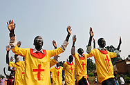 Members of a church group sing as they parade through the streets on a Sunday morning..Yei, Southern Sudan. 26/06/2011..Photo © J.B. Russell