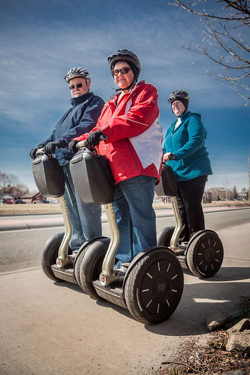 New York residents David and Cheryl Stone with their Segway guide, Marla, on Ninth Avenue, Anchorage