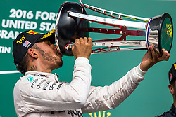 Formel 1: Grosser Preis der USA in Austin, Renntag / 231016<br /> <br /> ***Race winner Lewis Hamilton (GBR) Mercedes AMG F1 celebrates on the podium.<br /> 23.10.2016. Formula 1 World Championship, Rd 18, United States Grand Prix, Austin, Texas, USA, Race Day.<br /> ***