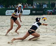 STARE JABLONKI POLAND - July 1: Doris Schwaiger /1/ and Stefanie Schwaiger /2/ of Austria in action during Day 1 of the FIVB Beach Volleyball World Championships on July 1, 2013 in Stare Jablonki Poland.  (Photo by Piotr Hawalej)