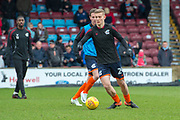 Scunthorpe United midfielder Ryan Yates (24) warming up fo the EFL Sky Bet League 1 match between Scunthorpe United and Rotherham United at Glanford Park, Scunthorpe, England on 10 February 2018. Picture by Craig Zadoroznyj.