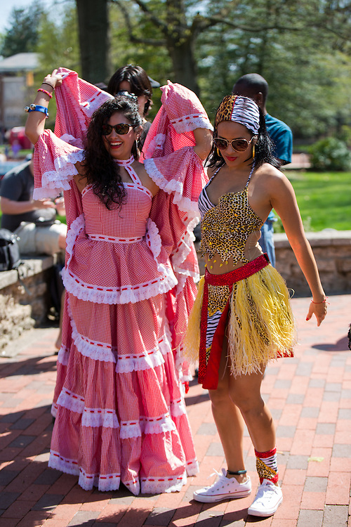 Jessica Gonzalea and Natalia Bultrago dance to drummers in College Green before the start of the 2015 International Street Fair.