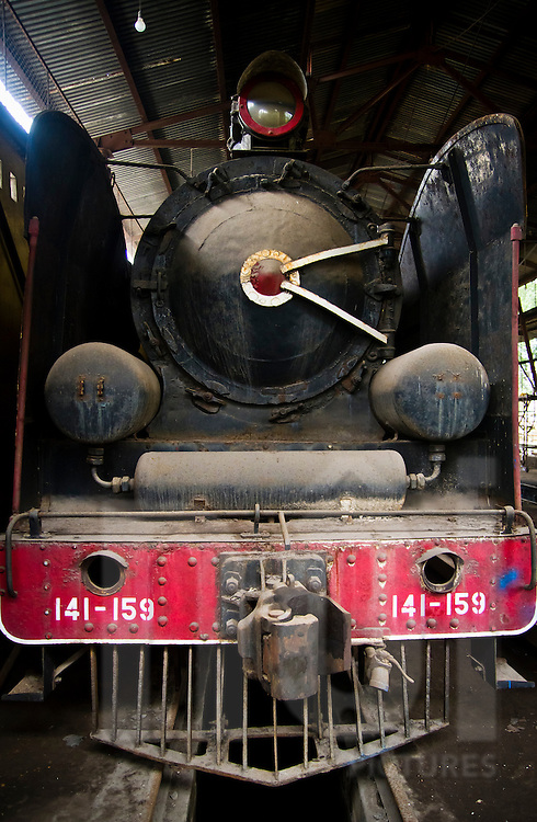 Detail of an old steam engine in the process of being restored for the museum, at a workshop in the Railway Worker's Khu Tap The, Hanoi, Vietnam, Asia