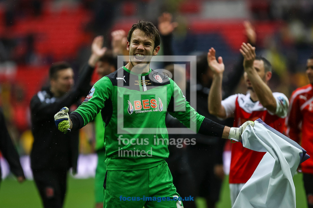 Chris Maxwell of Fleetwood Town celebrates at full time of the Sky Bet League 2 match at Wembley Stadium, London<br /> Picture by Daniel Chesterton/Focus Images Ltd +44 7966 018899<br /> 26/05/2014