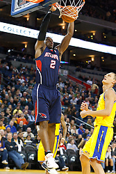 February 25, 2011; Oakland, CA, USA;  Atlanta Hawks shooting guard Joe Johnson (2) dunks in front of Golden State Warriors center Andris Biedrins (15) during the first quarter at Oracle Arena.