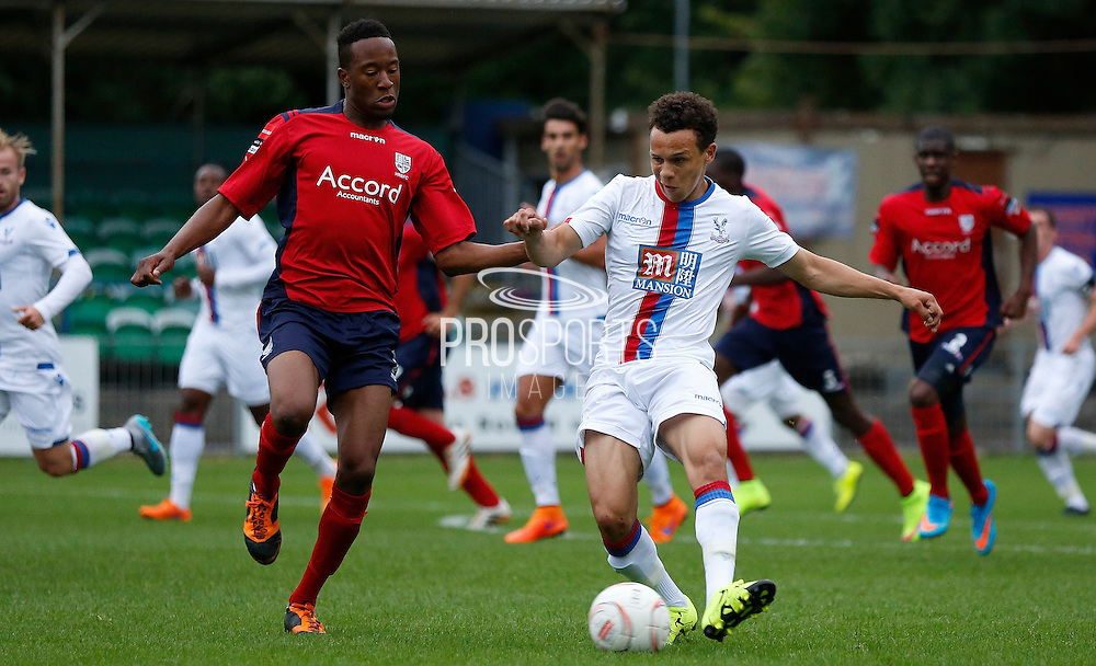 Spencer Forte playing the ball forward during the Pre-Season Friendly match between Hampton & Richmond and Crystal Palace at Beveree Stadium, Richmond Upon Thames, United Kingdom on 27 July 2015. Photo by Michael Hulf.