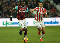Football - 2016 / 2017 Premier League - West Ham United vs. Stoke City<br /> <br /> Cheikhou Kouyate of West Ham and Ramadan Sobhi of Stoke City in a race for the ball at The London Stadium.<br /> <br /> COLORSPORT/DANIEL BEARHAM