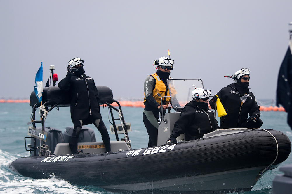 OKINAWA, JAPAN - JANUARY 20 : Japan Coast Guard is seen during the Anti-US base protest relocation at the new U.S Marine Airbase construction in Oura Bay, Camp Schwab, Henoko, Nago, Okinawa, Japan on Janaury 20, 2017. The scheduled reclamation area for new the construction totals 160 hectares and will include 2 runways. Construction of the new base will require 21 million cubic meters of soil, enough to fill the Okinawa Prefectural Office 70 times, 17 million tons of which will be hauled in from Kyushu and Shikoku. (Photo by Richard Atrero de Guzman/ANADOLU Agency)