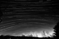 Winter Nighttime Sky Over New Jersey. Composite star trail image 02:30-05:29) taken with a Nikon D810a camera and 19 mm f/4 PC-E lens (ISO 400, 19 mm, f/8, 120 sec). Raw images processed with Capture One Pro and the composite created with Photoshop CC (statistics, maximum). Conversion to B&W with Capture One Pro.