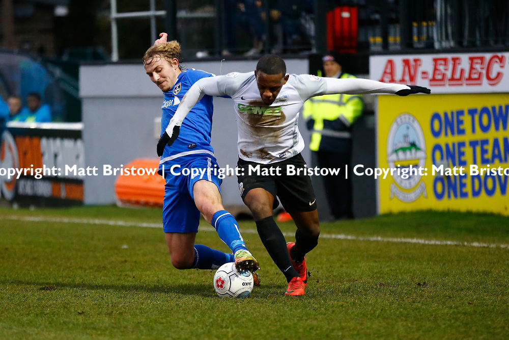 Guiseleys defender Jake Sheppard tackles Dover's forward Anthony Jeffrey during the Vanorama National League match between Dover Athletic and Guiseley at Crabble Stadium, London, England on 27 January 2018. Photo by Matt Bristow.