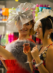Kate Podles and Eliza Swenarek enjoy dressing up at Allure Medi Spa in Debenhams at Ocean Terminal to get ready for Ladies Day at Musselburgh Race Course. 11 June 2012 (Ger Harley | StockPix).