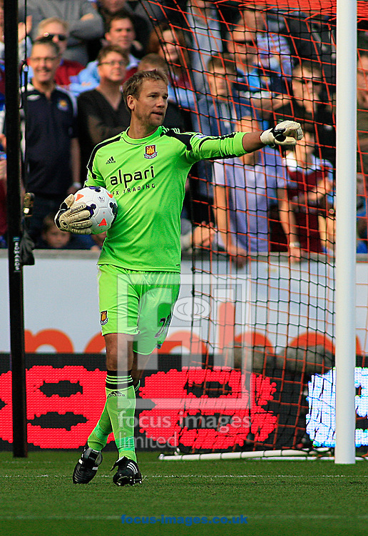 Picture by Richard Gould/Focus Images Ltd +44 7855 403186<br /> 28/09/2013<br /> Jussi J&auml;&auml;skel&auml;inen of West Ham United in action  during the Barclays Premier League match at the KC Stadium, Kingston upon Hull.