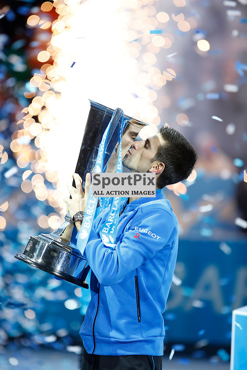 Novak Djokovic lift the trophy for winning the ATP World Tour Final match between Novak Djokovic and Roger Federer at the O2 Arena, London 2015.  on November 22, 2015 in London, England. (Credit: SAM TODD | SportPix.org.uk)