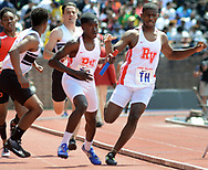 Rancocas Valley's Vince Brown (left) takes the baton from Daequan Jackson-Swoope during the High School Boys' 4x400 South Jersey Large race at the 124th running of the Penn Relays Saturday, April 28, 2018 in Philadelphia. (Photo by William Thomas Cain)