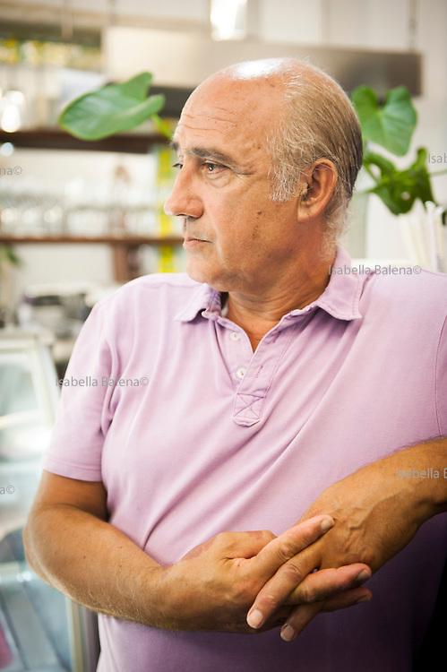 """Vito Fiorino, Lampedusa, Sicilia, Italy, ott 2013. E' colui che ha salvato 47 migranti la notte del 3 ottobre 2013. Ha un bar gelateria """"Peccati di gola"""". Lampedusa island, Sicily, Italy. Vito Fiorino is the man who rescued 47 migrants"""