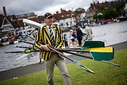 © Licensed to London News Pictures. 28/06/2017. London, UK. A man wearing the colours of Northwich Rowing Club carrying oars on day one of the Henley Royal Regatta, set on the River Thames by the town of Henley-on-Thames in England.  Established in 1839, the five day international rowing event, raced over a course of 2,112 meters (1 mile 550 yards), is considered an important part of the English social season. Photo credit: Ben Cawthra/LNP