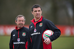 CARDIFF, WALES - Monday, March 21, 2011: Wales' manager Gary Speed MBE and Under-21 manager Brian Flynn during a training session at the Vale of Glamorgan ahead of the UEFA Euro 2012 qualifying Group G match against England. (Photo by David Rawcliffe/Propaganda)