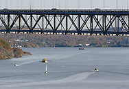 Fort Montgomery, NY - Cars cross the Bear Mountain Bridge while boats sail on the Hudson River on Nov. 2, 2008.