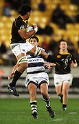 Wellington number eight Victor Vito takes a high ball under pressure from Paul Williams.<br /> Air NZ Cup Ranfurly Shield match - Wellington Lions v Auckland at Westpac Stadium, Wellington, New Zealand. Saturday, 22 August 2009. Photo: Dave Lintott/PHOTOSPORT